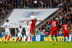Chris Smalling of England is challenged by Nani of Portugal - Mandatory byline: Rogan Thomson/JMP - 02/06/2016 - FOOTBALL - Wembley Stadium - London, England - England v Portugal - International Friendly.