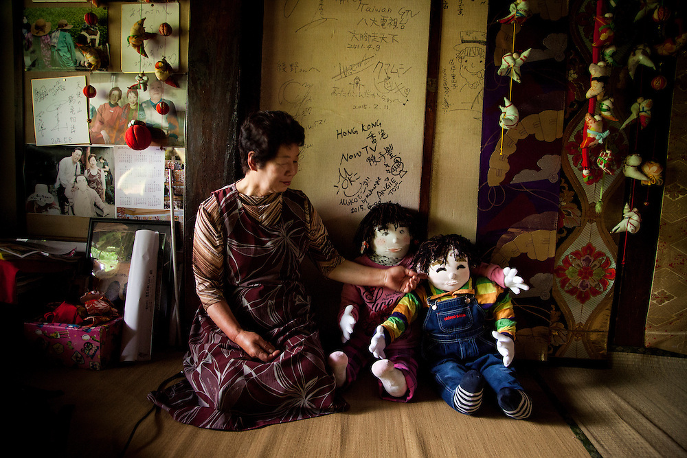 MIYOSHI, JAPAN - JULY 11 : Resident Tsukimi Ayano sit with her hand made doll inside her house in Nagoro village, in Miyoshi, Japan on July 11, 2015. <br /> <br /> Photo: Richard Atrero de Guzman