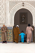MARRAKESH, MOROCCO - 19TH APRIL 2016 - Locals to Marrakesh enter the Zaouia / zawiya burial tomb shrine site of Sidi Bel Abbas (Abu al-Abbas) al-Sabti, Marrakesh, Morocco.