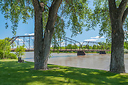 Riverfront park and historic bridge over the Missouri River in Fort Benton, Montana.