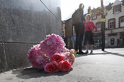 © Licensed to London News Pictures. 12/07/2019. London, UK. Flowers are placed outside a Pizza Express after a fight took place in Purley, south London where a teenager was murdered and two others were injured, including the murder suspect. Photo credit: Peter Macdiarmid/LNP