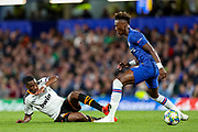 Valencia CF midfielder Geoffrey Kondogbia (6) avoids a challenge from Chelsea forward Tammy Abraham (9) during the Champions League match between Chelsea and Valencia CF at Stamford Bridge, London, England on 17 September 2019.