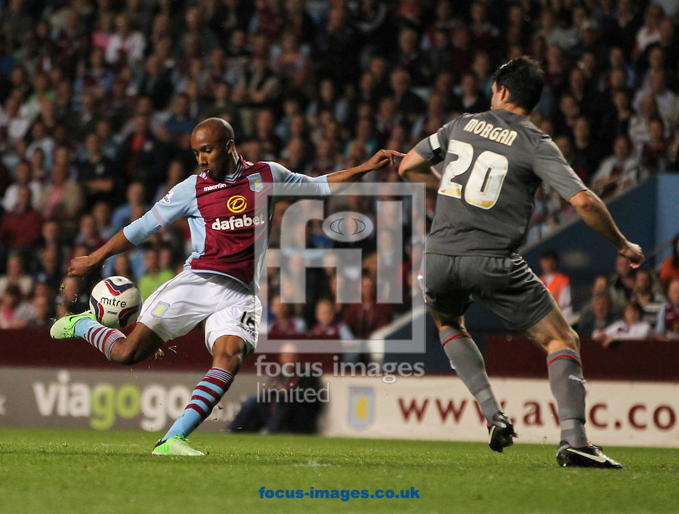 Picture by Tom Smith/Focus Images Ltd 07545141164<br /> 28/08/2013<br /> Fabian Delph (left) of Aston Villa makes it 3-0 during the Capital One Cup match at Villa Park, Birmingham.