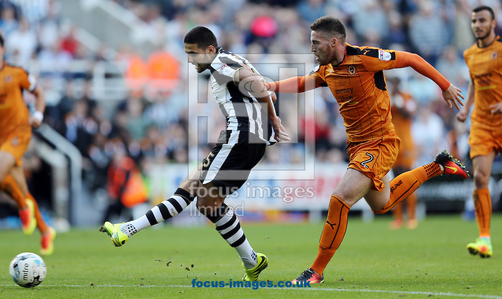 Aleksandar Mitrovic (l) of Newcastle United shooting and Matt Doherty of Wolverhampton Wanderers during the Sky Bet Championship match at St. James's Park, Newcastle<br /> Picture by Simon Moore/Focus Images Ltd 07807 671782<br /> 17/09/2016