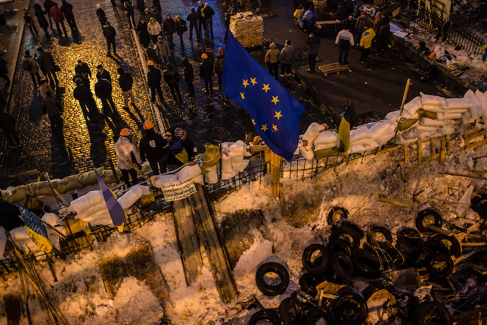 KIEV, UKRAINE - DECEMBER 12: Anti-government protesters stand around a large barricade made of snow and debris near Independence Square on December 12, 2013 in Kiev, Ukraine. Thousands of people have been protesting against the government since a decision by Ukrainian president Viktor Yanukovych to suspend a trade and partnership agreement with the European Union in favor of incentives from Russia. (Photo by Brendan Hoffman/Getty Images) *** Local Caption ***