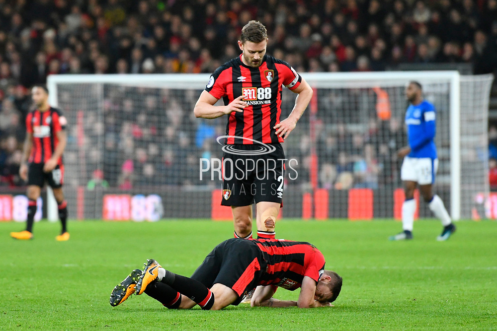 Dan Gosling (4) of AFC Bournemouth down with an injury with Simon Francis (2) of AFC Bournemouth watching him during the Premier League match between Bournemouth and Everton at the Vitality Stadium, Bournemouth, England on 30 December 2017. Photo by Graham Hunt.