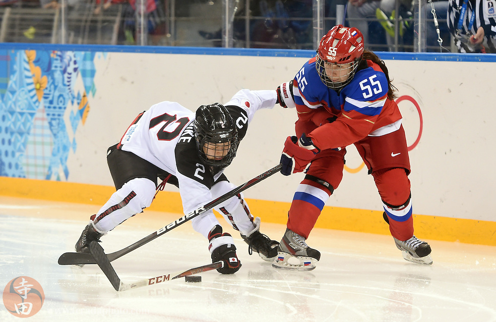 Feb 16, 2014; Sochi, RUSSIA; Russia forward Galina Skiba (55) reaches for the puck with Japan defenseman Shiori Koike (2) in a women's ice hockey classifications round game during the Sochi 2014 Olympic Winter Games at Shayba Arena.