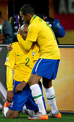 Maicon and Robinho of Brazil celebrate after Maicon scored fist goal during the 2010 FIFA World Cup South Africa Group G match between Brazil and North Korea at Ellis Park Stadium on June 15, 2010 in Johannesburg, South Africa.  (Photo by Vid Ponikvar / Sportida)