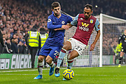 Chelsea midfielder Christian Pulisic (22) tussles with Aston Villa defender Ahmed El Mohamady during the Premier League match between Chelsea and Aston Villa at Stamford Bridge, London, England on 4 December 2019.
