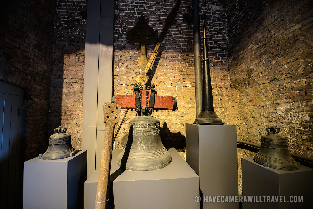 Examples of some of the bells that chime on display in an exhibit in the Belfry of Bruges. The Belfry (or Belfort) is a medieval bell tower standing above the Markt in the historic center of Bruges. The first stage was built in 1240, with further stages on top built in the late 15th century. The Carillon consists of 47 bells. 26 bells were cast by Georgius Dumery between 1742 and 1748 and 21 bells were cast by Koninklike Eijsbouts in 2010. The bourdon weights 6 tons, and the bells have a combined weight of 27 tons.