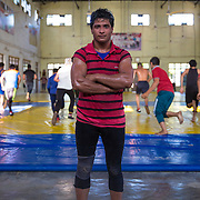 HARYANA, INDIA - MARCH 30, 2016: Indian wrestler Neetu Sarkar, 21, poses for a picture at her training center in Haryana, India. <br />