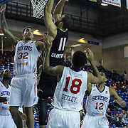 Erie BayHawks Guard Drew Crawford (11) drives towards the basket as Delaware 87ers Forward Drew Gordon (32) and Delaware 87ers Guard DJ Seeley (18) defends in the first half of a NBA D-league regular season basketball game between the Delaware 87ers and the Erie BayHawk (Orlando magic) Friday, Jan. 02, 2015 at The Bob Carpenter Sports Convocation Center in Newark, DEL