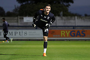 AFC Wimbledon goalkeeper Joe McDonnell (24) warming up during the EFL Sky Bet League 1 match between AFC Wimbledon and Bradford City at the Cherry Red Records Stadium, Kingston, England on 2 October 2018.