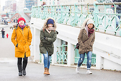 "© Licensed to London News Pictures. 18/03/2018. Brighton, UK. Members of the public dress up for near freezing temperatures as a second ""Beast from the East"" is hitting the South Coast with snow and cold wind. Photo credit: Hugo Michiels/LNP"