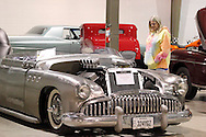 Susan Lewis of Joplin, Missouri looks at Kelly Smith of Arcanum's 1949 Buick boattail during the KOI Hot Rod Fest Dayton at the Dayton Airport Expo Center in Vandalia, Sunday, March 12, 2012.  She's traveling with husband Ronald, who works as a pipefitter, and noticed later that the missing hood seems to have been welded in behind the seats, where the trunk would normally be.