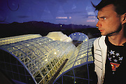 USA_SCI_BIOSPH_88_xs <br /> Biosphere 2 Project undertaken by Space Biosphere Ventures, a private ecological research firm funded by Edward P. Bass of Texas.  Biosphere candidate Mark Van Thillo in the habitat library. Biosphere 2 was a privately funded experiment, designed to investigate the way in which humans interact with a small self-sufficient ecological environment, and to look at possibilities for future planetary colonization. The $30 million Biosphere covers 2.5 acres near Tucson, Arizona, and was entirely self- contained. The eight 'Biospherian's' shared their air- and water-tight world with 3,800 species of plant and animal life. The project had problems with oxygen levels and food supply, and has been criticized over its scientific validity. 1990