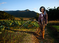 KYAING TONG, MYANMAR - CIRCA DECEMBER 2017: Portrait of farmer woman around Kyaing Tong watering her garden.