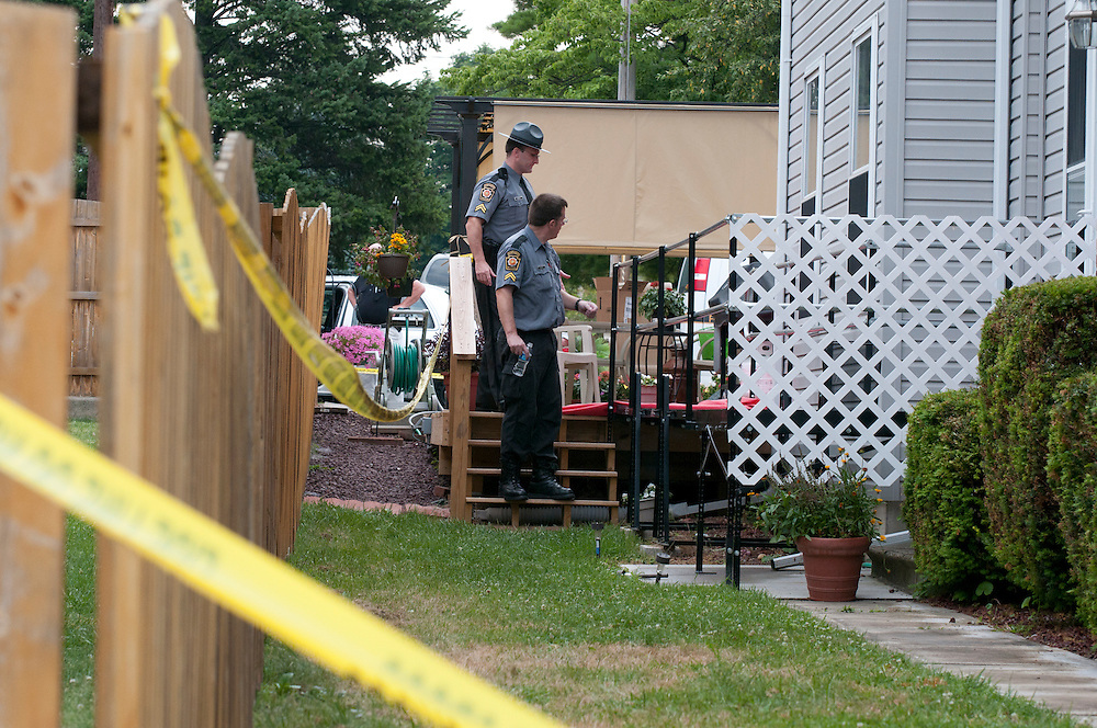 6/27/2010 Northampton, PA Troopers from the Pennsylvania State Police surround a crime scene where 4 people were murdered on Saturday. Express Times Photo   CHRIS POST