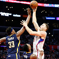 04 December 2016: LA Clippers forward Blake Griffin (32) goes for the baby hook over Indiana Pacers center Myles Turner (33) and Indiana Pacers guard Jeff Teague (44) during the Indiana Pacers 111-102 victory over the LA Clippers, at the Staples Center, Los Angeles, California, USA.