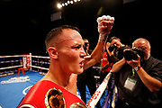 Josh Warrington celebrates winning the fight holding the world title belt after the Josh Warrington Sofiane Takoucht IBF featherweight title fight at First Direct Arena, Leeds, United Kingdom on 12 October 2019.