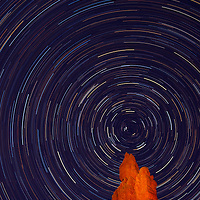 Star trails recorded while painting Hoodoo with light from spotlight in Red Canyon near Bryce National Park in Utah.