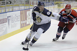 11 November 2006: Jeff Mushaluk steers the puck in the corner.&#xD;The Elmira Jackals met the Bloomington PrairieThunder at the U.S. Cellular Coliseum in Bloomington Illinois.<br />