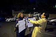 Roma 15 Novembre 2011.Pacifisti manifestano nei pressi dell'Ambasciata Israeliana, contro Israele e le testate nucleari che detiene e  per le minacce contro l'Iran. I manifestanti chiedono che  Mordechai Vanunu,l'ingegnere nucleare che svelo' al mondo l'armamento nucleare israeliano possa lasciare  lo stato d'Israele, cosa che gli è vietata..Il corrispondente del Islamic Republic of Iran Broadcasting intervista una manifestante
