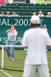 Liverpool, England - Tuesday, June 12, 2007: A spectator takes on Vince Spadea on day one of the Liverpool International Tennis Tournament at Calderstones Park. For more information visit www.liverpooltennis.co.uk. (Pic by David Rawcliffe/Propaganda)