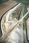 Nederland, Hoeksche Waard, Molendijk, 08-03-2002; de Molendijk begint midden boven en loopt met een bocht langs de rechter kant vd foto; deze dijk wordt verlegd ivm de bouw van de HSL (zand reeds in het landschap) en krijgt een groot viaduct (het zand links beneden); de werkweg van de HSL (en toekomstig trace) loopt diagonaal (vanaf linksonder) en doorsnijdt de (nieuwe) dijk; infrastructuur verkeer en vervoer spoor bouw zandlichaam, abstarct;<br /> luchtfoto (toeslag), aerial photo (additional fee)<br /> foto /photo Siebe Swart
