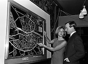 11/11/1964<br /> 11 November 1964<br /> <br /> Mr. and Mrs. Cyril D. Duff manager with Dublin Regional Tourism Organisation using the new display.