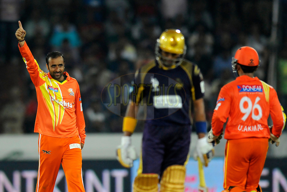 Adnan Rasool of Lahore Lions celebrates the wicket of Robin Uthappa of Kolkata Knight Riders during match 7 of the Oppo Champions League Twenty20 between the Kolkata Knight Riders and the Lahore Lions held at the Rajiv Gandhi Cricket Stadium, Hyderabad, India on the 21st September 2014<br /> <br /> Photo by:  Pal Pillai / Sportzpics/ CLT20<br /> <br /> <br /> Image use is subject to the terms and conditions as laid out by the BCCI/ CLT20.  The terms and conditions can be downloaded here:<br /> <br /> http://sportzpics.photoshelter.com/gallery/CLT20-Image-Terms-and-Conditions-2014/G0000IfNJn535VPU/C0000QhhKadWcjYs