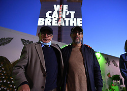 "© Licensed to London News Pictures. 05/07/2020. London, UK. <br /> <br /> El Alami Hamdan (LEFT) and Abbas Dadou (RIGHT) attend a light projection reading 'WE CAN'T BREATHE' is cast onto the shell of Grenfell Tower in West London on the eve of the second phase of the Grenfell Tower Fire Inquiry. <br /> <br /> Abbas Dadou, Chairman of Lancaster West Estate Residents Association comprising 800 homes and 2000 residents said ""We stand in solidarity with the families who lost their loved ones in their fight for justice. They are us and we are with them. They are part of our community and their fight for justice is our fight."" El Alami Hamdan who lost his daughter and his grandchildren in the fire said ""how long must we wait for justice? It has been three years and still nothing. They promise everything and they do nothing.'  <br />  <br /> A press conference will be held this morning ahead of the Inquiry resuming, where a full statement will be released at 10am ""Family members of those who perished in the fire that took the lives of 72 people on June 14 in 2017 attended the projection of 'We can't breathe' These words echo what we heard on the 999 calls of our loved ones, or the last breath taken by our brothers and sisters, mothers and fathers and our children that night as they begged for help. We have had to listen to these calls as part of the Inquiry reliving their pain and suffering and the failures which cost the lives of our loved ones that night.  We are no longer going to keep silent. We demand justice. We want prosecutions. Our loved ones are not here to speak for themselves and we must speak for them"".  Photo credit: Guilhem Baker/LNP"