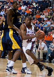 Virginia guard Sean Singletary (44) dribbles around Drexel center Frank Elegar (15).  The #23 Virginia Cavaliers men's basketball team faced the Drexel Dragons  at the John Paul Jones Arena in Charlottesville, VA on November 20, 2007.