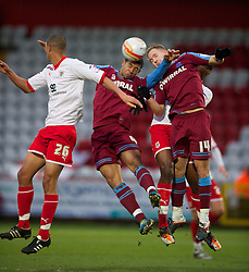 STEVENAGE, ENGLAND - Saturday, December 17, 2011: Tranmere Rovers' Joss Labadie and Adam McGurk in action against Stevenage during the Football League One match at Broadhall Way. (Pic by David Rawcliffe/Propaganda)