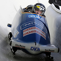 28 February 2007:    The Germany 2 bobsled driven by Andre Lange with sidepushers Alexander Roediger and Kevin Kuske, and brakeman Martin Putze goes through turn 19 in the 1st run at the 4-Man World Championships competition on February 27 at the Olympic Sports Complex in Lake Placid, NY.