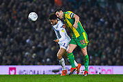 Tyler Roberts of Leeds United (11) and Gareth Barry of West Bromwich Albion (18) in action during the EFL Sky Bet Championship match between Leeds United and West Bromwich Albion at Elland Road, Leeds, England on 1 March 2019.