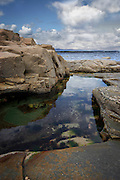 Coastal rockpool, Mullaghmore Co. Sligo, mirroring the sky