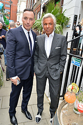 Left to right, DAVID FURNISH and GIANCARLO GIAMETTI at the launch of the new collection from Limoland held at Anderson & Sheppard's Haberdashery, 17 Clifford Street,London on 16th June 2014.