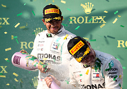 MELBOURNE, March 17, 2019  Second-placed Mercedes driver Lewis Hamilton (L) of Britain celebrates with first-placed teammate Valtteri Bottas of Finland during the awarding ceremony of Formula 1 Australian Grand Prix 2019 at the Albert Park in Melbourne, Australia, March 17, 2019. (Credit Image: © Bai Xuefei/Xinhua via ZUMA Wire)