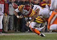 November 18, 2011: Iowa State Cyclones quarterback Jared Barnett (16) fumbles the ball as he is hit by Oklahoma State Cowboys cornerback Andrae May (16) and Oklahoma State Cowboys linebacker James Thomas (22) during the the NCAA football game between the Oklahoma State Cowboys and the Iowa State Cyclones at Jack Trice Stadium in Ames, Iowa on Friday, November 18, 2011. Iowa State upset Oklahoma State 37-31 double overtime.