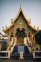 Chiang Mai, Thailand -- May 20, 2017: A small golden temple in the Old Town of Chiang Mai, Thailand.