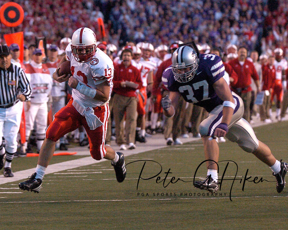 Nebraska quarterback Zac Taylor (13) scrambles past Kansas State linebacker Marcus Perry (37) for a first down in the first half at Bill Snyder Family Stadium in Manhattan, Kansas, October 14, 2006.  The Huskers beat the Wildcats 21-3.<br />