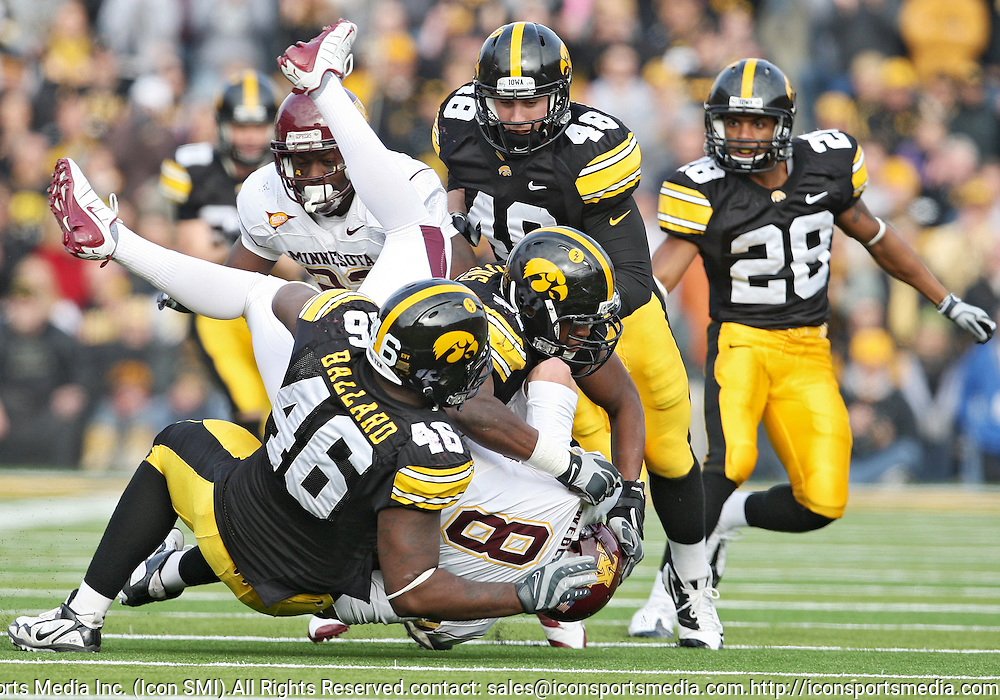 November 21, 2009: Minnesota quarterback Adam Weber (8) is hit by Iowa defensive tackle Christian Ballard (46) and Iowa defensive tackle Broderick Binns (91) during the first half of the Iowa Hawkeyes 12-0 win over the Minnesota Golden Gophers at Kinnick Stadium in Iowa City, Iowa on November 21, 2009.