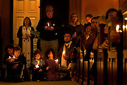 Many gather at the First Unitarian Church in Portland to mark the 3,000th American military death in Iraq. (LtoR front) Marie Taylor and her son Logan Watkins, 8, with Isaac, 3, Clarissa, 5, and Edward Jacobowitz join in a candle lighting vigil with song....