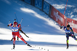 Emil Hegle Svendsen (NOR) and Jean Guillaume Beatrix (FRA) at the finish sprint during Men 15 km Mass Start at day 4 of IBU Biathlon World Cup 2015/16 Pokljuka, on December 20, 2015 in Rudno polje, Pokljuka, Slovenia. Photo by Ziga Zupan / Sportida