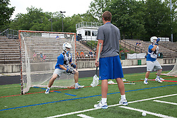 29 May 2010: Duke Blue Devils assistant coach Pat DeBolt with goalkeeper Dan Wigrizer (19) during practice at Essex Community College in Baltimore, MD.