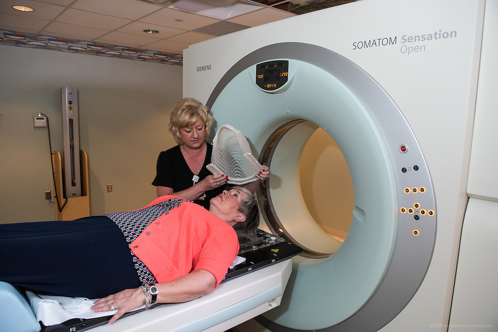 Radiation Therapist Tina Hall assists Cyberknife patient Debra Rooke, photographed Thursday, May 21, 2015 at Baptist Health in Lexington, Ky. (Photo by Brian Bohannon/Videobred for Baptist Health)
