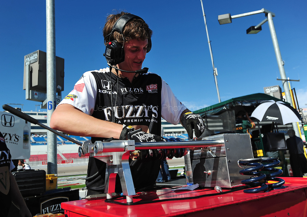 Oct. 14 2011; Las Vegas, NV, USA; Indy Car series crew member to driver Buddy Rice (not pictured) works during practice for the IZOD IndyCar World Championships at Las Vegas Motor Speedway.  Mandatory Credit: Jennifer Stewart-US PRESSWIRE