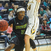 UNCW's Jasmine Steele drives around Drexel's Rachel Pearson Sunday February 1, 2015 at Trask Coliseum on the campus of UNCW. (Jason A. Frizzelle)