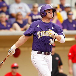 Apr 04, 2010; Baton Rouge, LA, USA; LSU Tigers first baseman Blake Dean hits a two run double against the Georgia Bulldogs during a game at Alex Box Stadium. Mandatory Credit: Derick E. Hingle-US PRESSWIRE